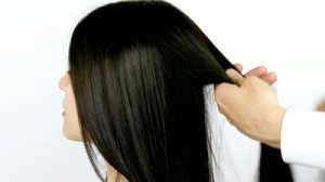 stock-footage-beautiful-long-black-hair-being-combed